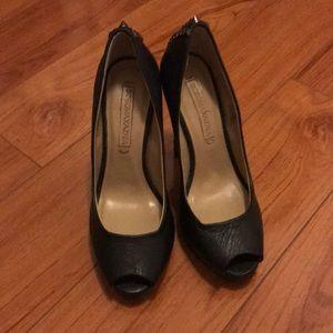 BCBG Maxazria black leather peep toe pumps